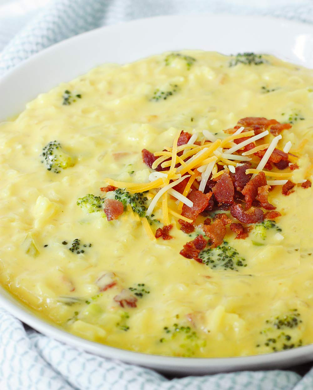 Cheesy Broccoli Rice Soup with Bacon from Soupaddict.com